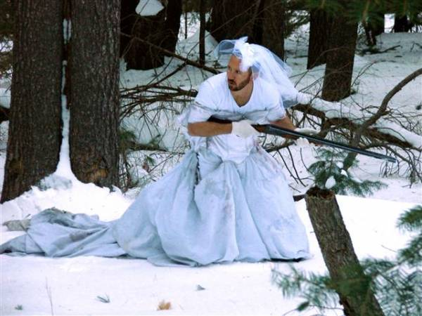 Best use for ex-wife's wedding dress… snow camo!