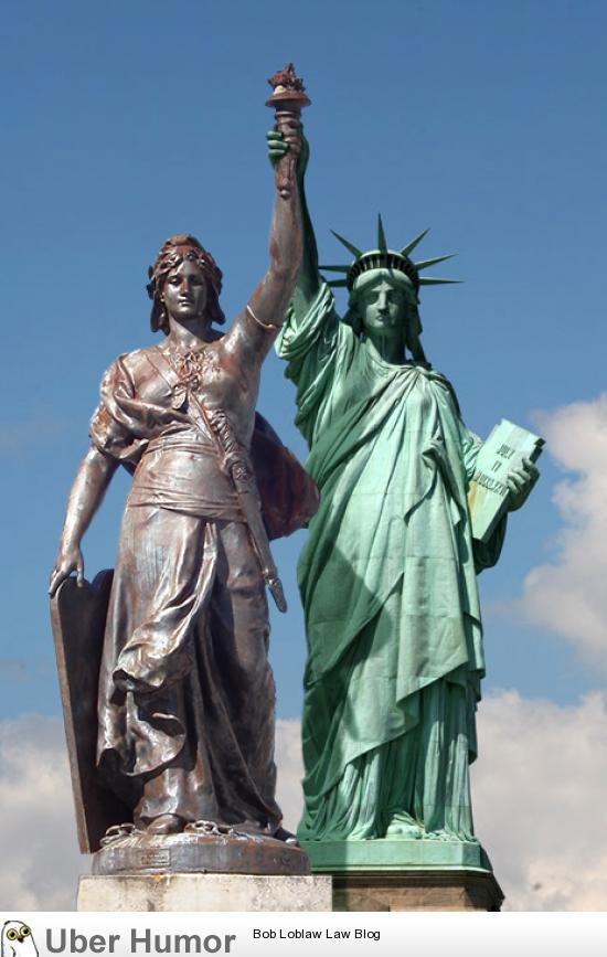 Two French statues. France grows twice as strong today.
