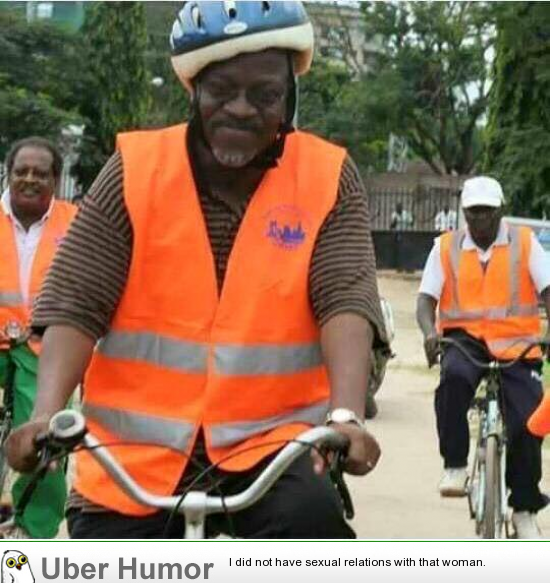 Tanzania's President biking home after leading street-cleaning exercise.