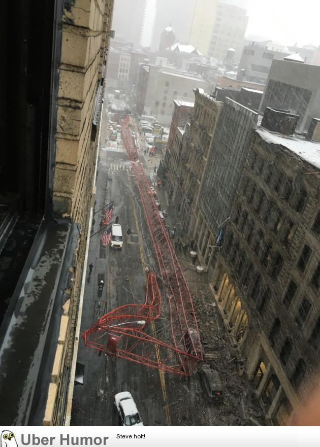 A crane collapsed in the middle of the street in New York City today. | uberHumor.com