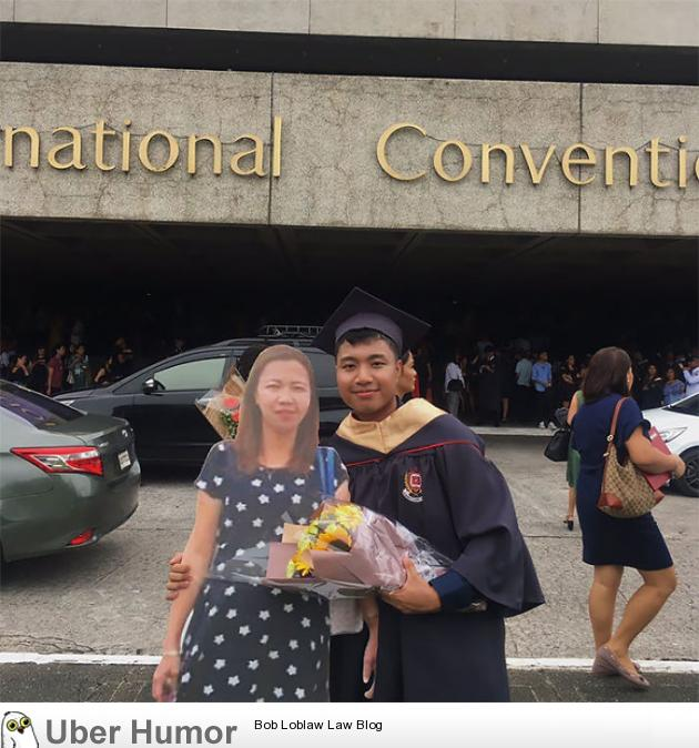 Paulo John posing with a life-sized cutout of his deceased mother on his graduation ceremony. His mother promised him that she'll be on his graduation, but she died of pneumonia last 2016. | uberHumor.com
